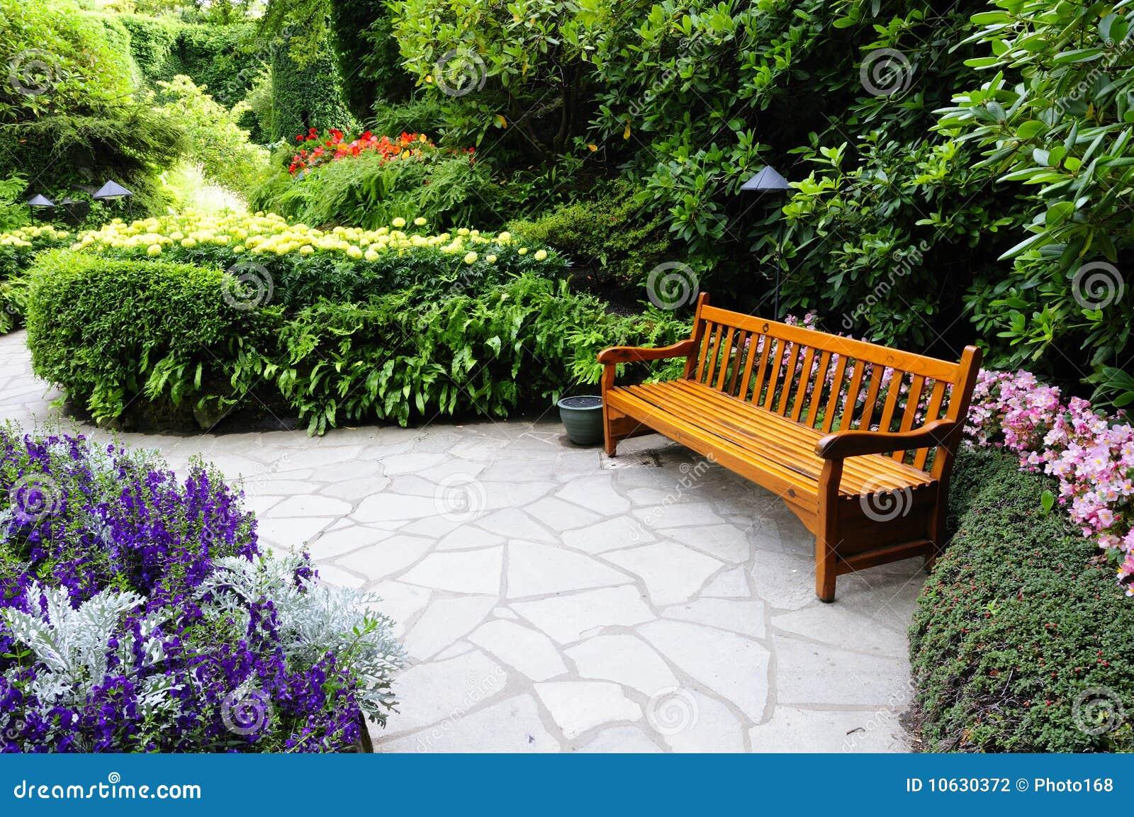 Wooden bench in Butchart Garden