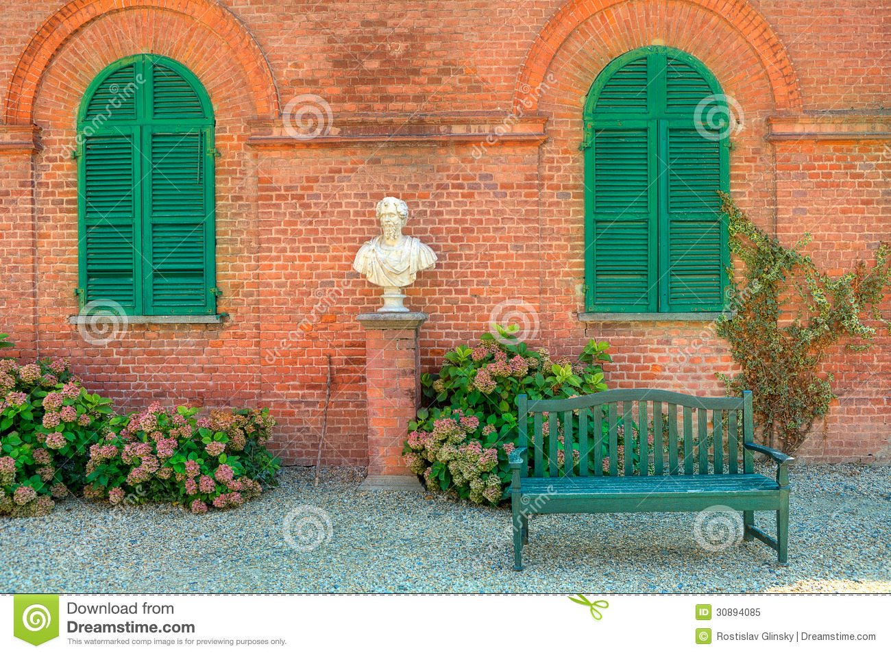Wooden Bench In Front Of Red Brick House In Italy. Royalty ...