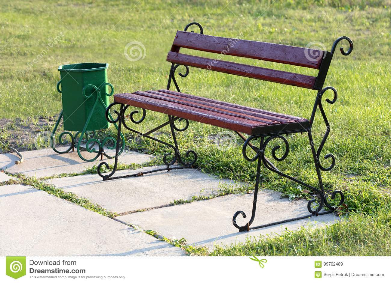 Superb An Old Wooden Bench Stands On The Lawn In The Park And Is Machost Co Dining Chair Design Ideas Machostcouk