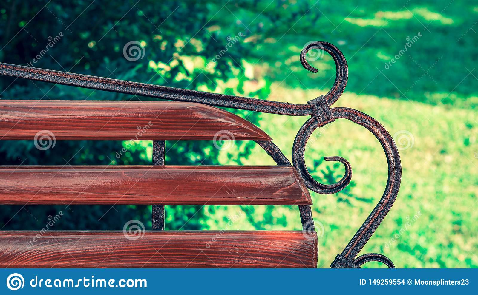 Enjoyable Wooden Bench With Metal Art Forging In The Amusement Park Pabps2019 Chair Design Images Pabps2019Com