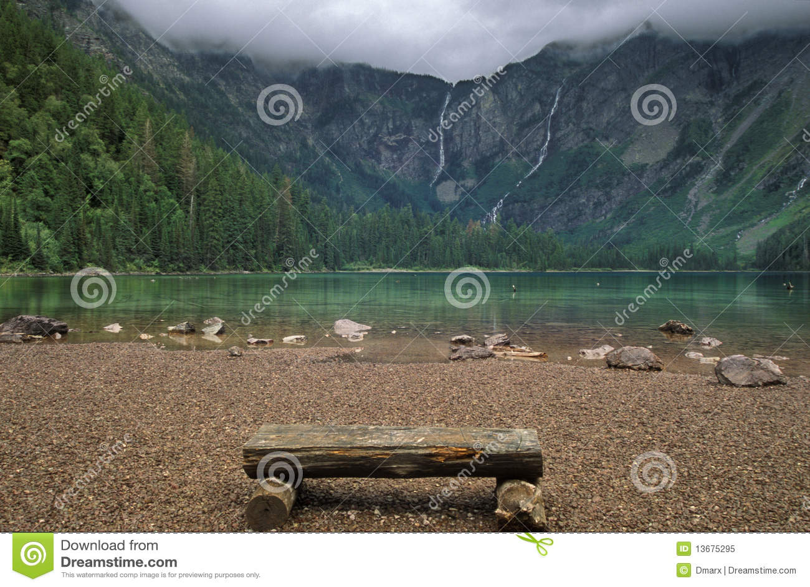 Wooden Bench Near A Mountain Lake Royalty Free Stock Photo