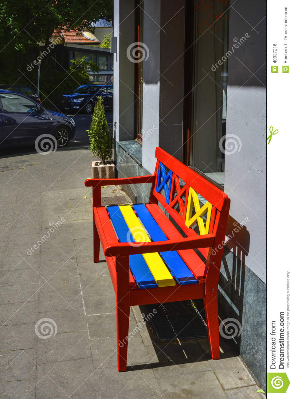 Wooden bench, painted in red, yellow and blue