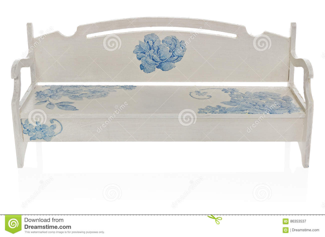 The wooden bench painted white with a pattern of blue flowers.