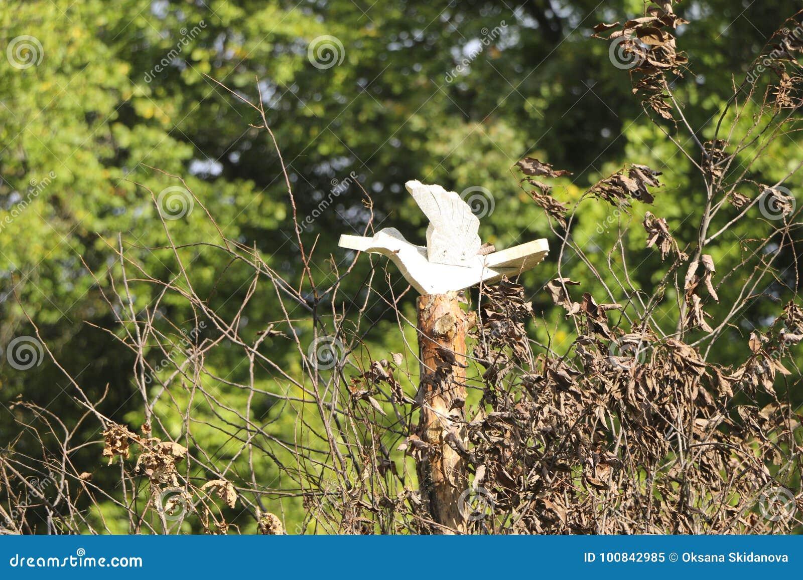 Wooden bird Slavic symbols