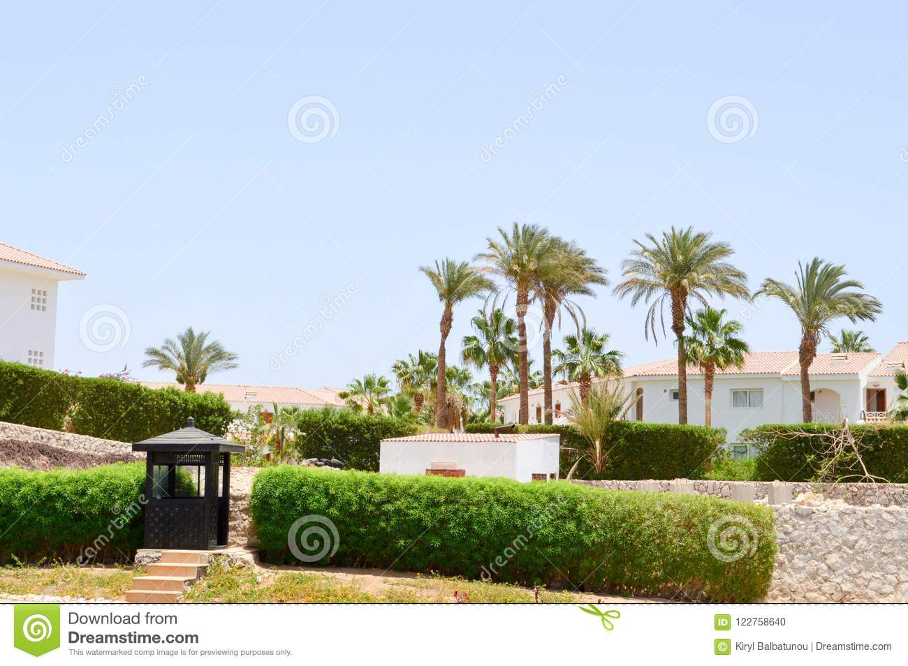 wooden black guard booth guarding post outdoors warm tropical exotic country spa background background green plants palm trees