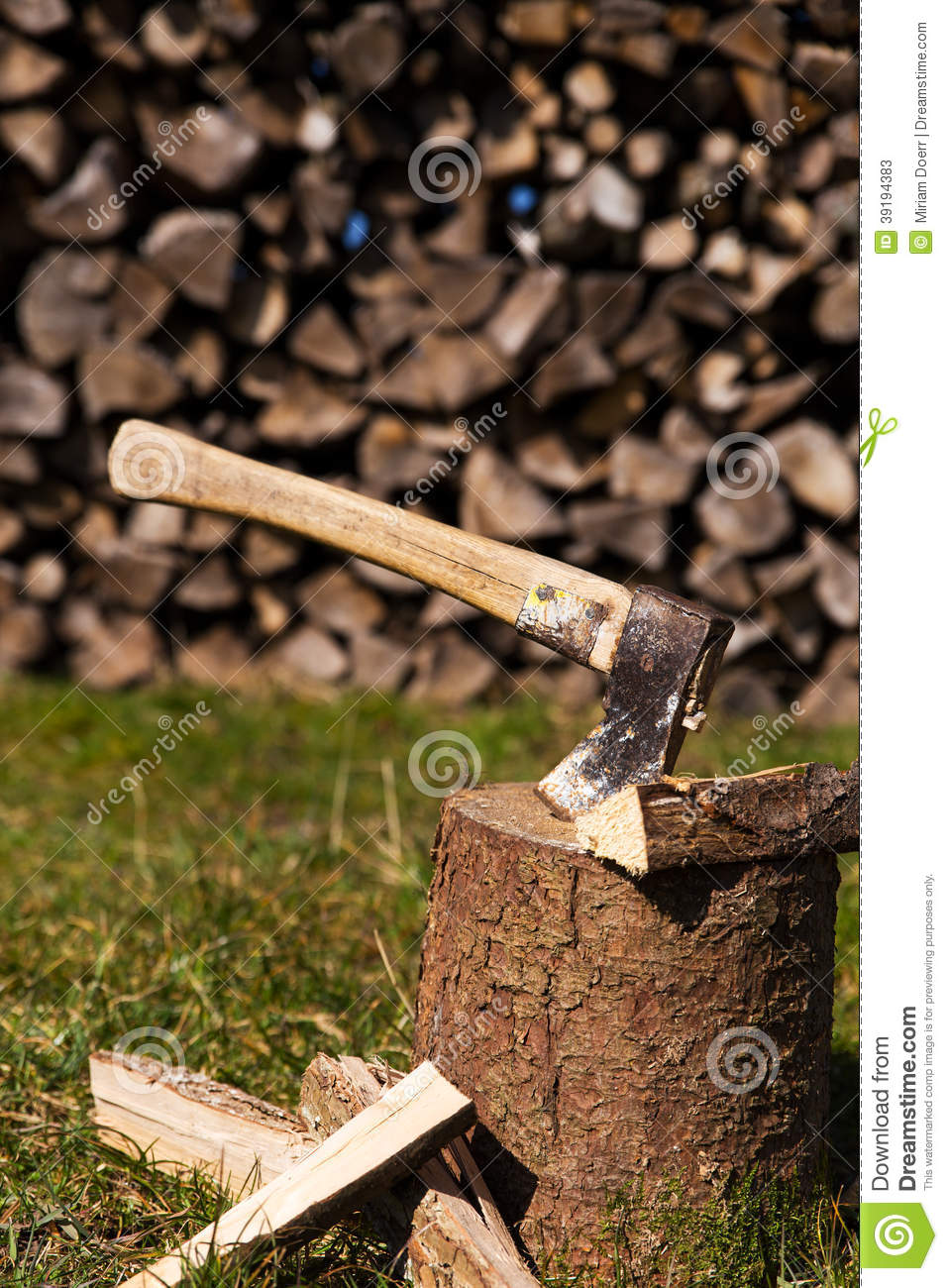 Wooden block with ax and split wood stock image of