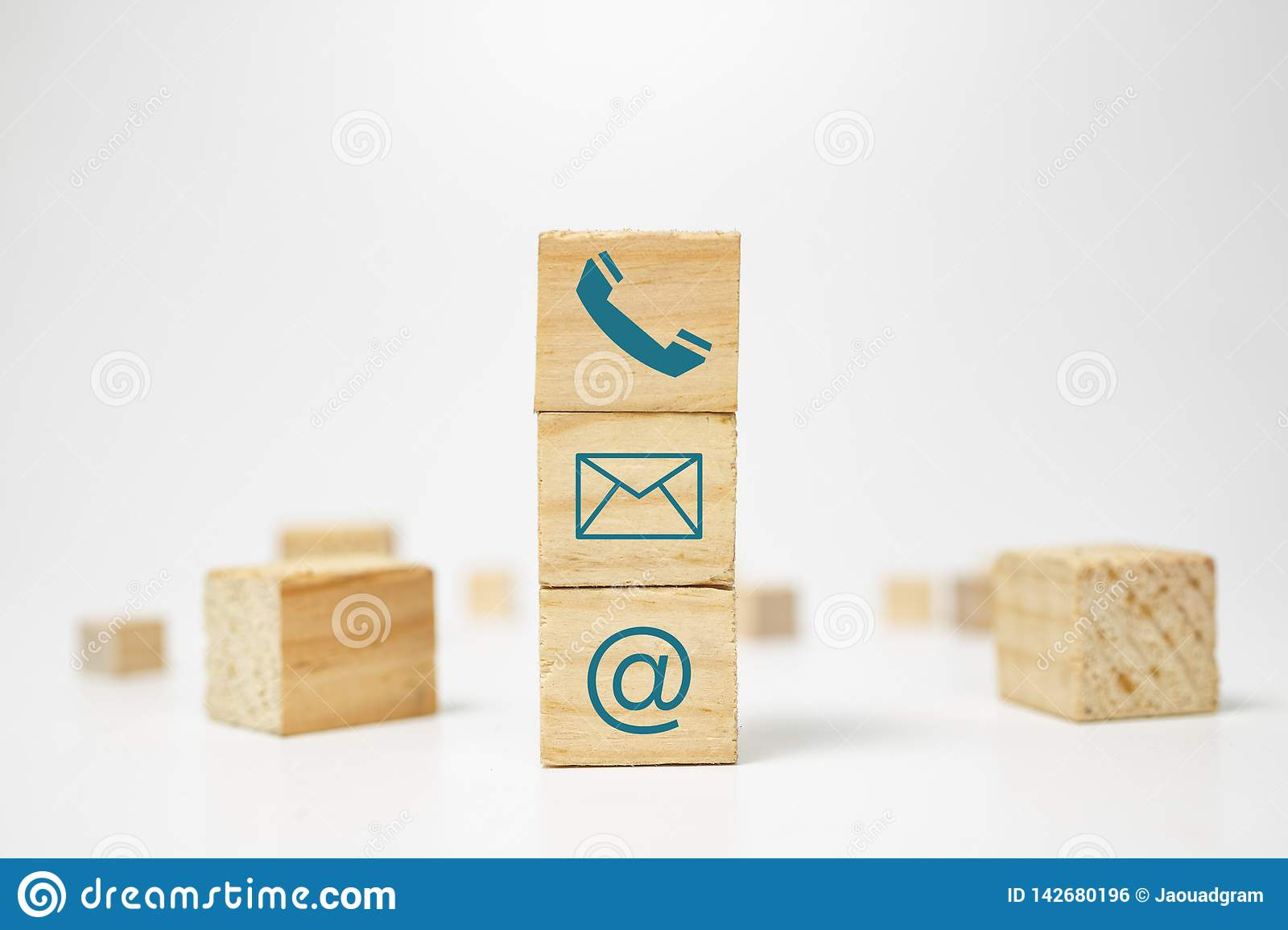 Wooden block cube symbol telephone, email, address. Website page contact us or e-mail marketing concept