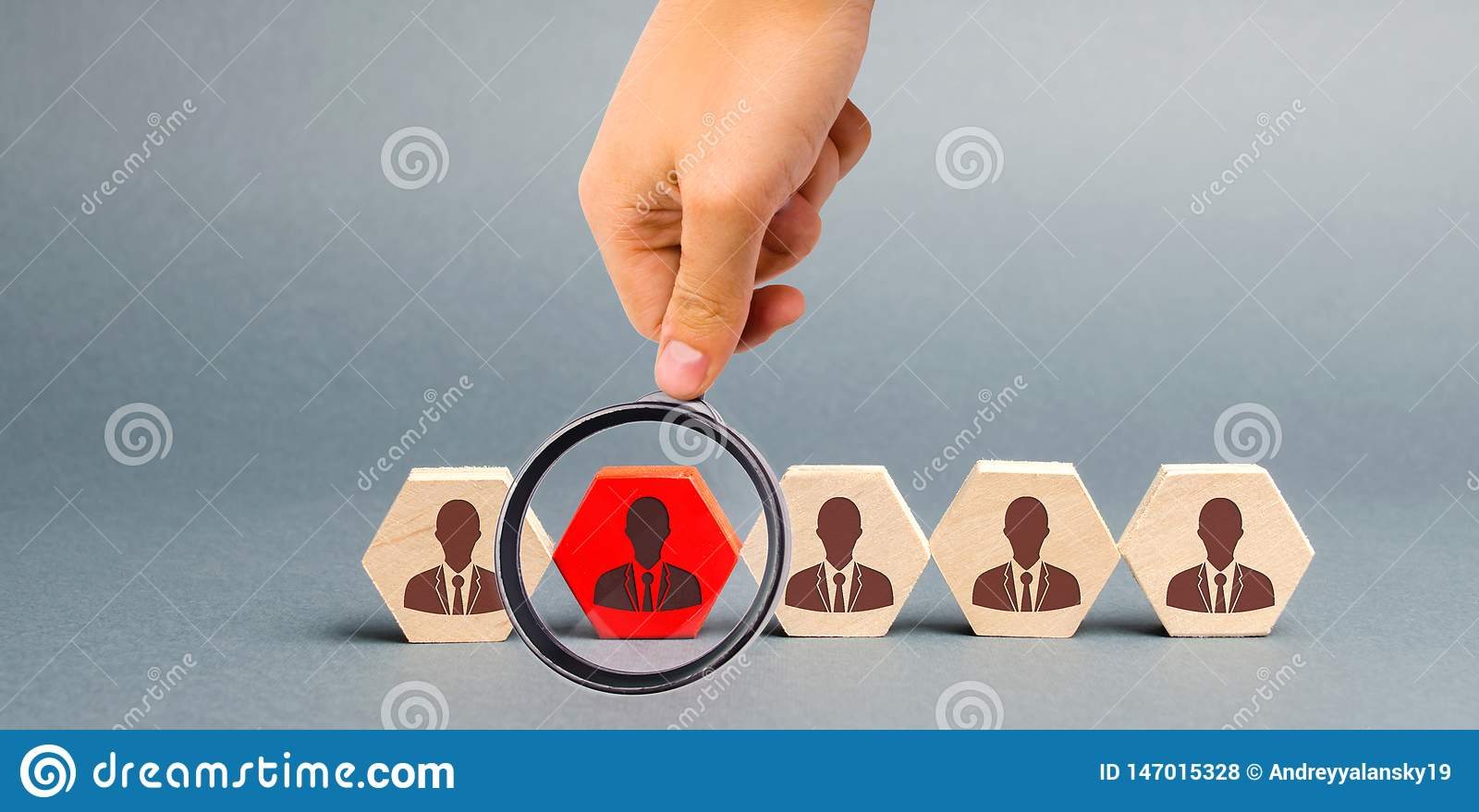Wooden blocks with the image of workers. The concept of personnel management in the company. Dismissing an employees from a team.