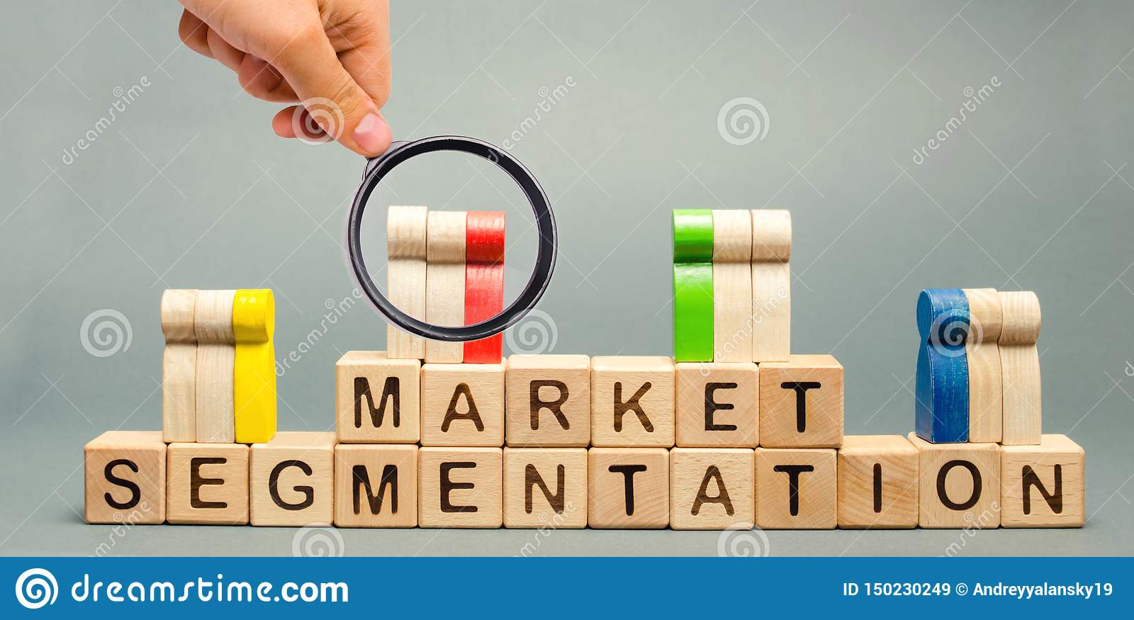 Wooden blocks with the word Market Segmentation and multicolored groups of people. Target audience, customer care. Market group of