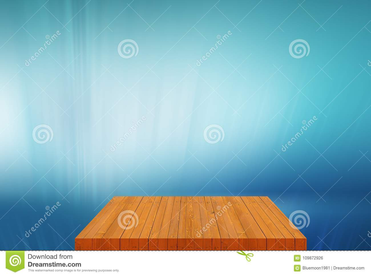 Wooden board empty table top with plain blue background concept