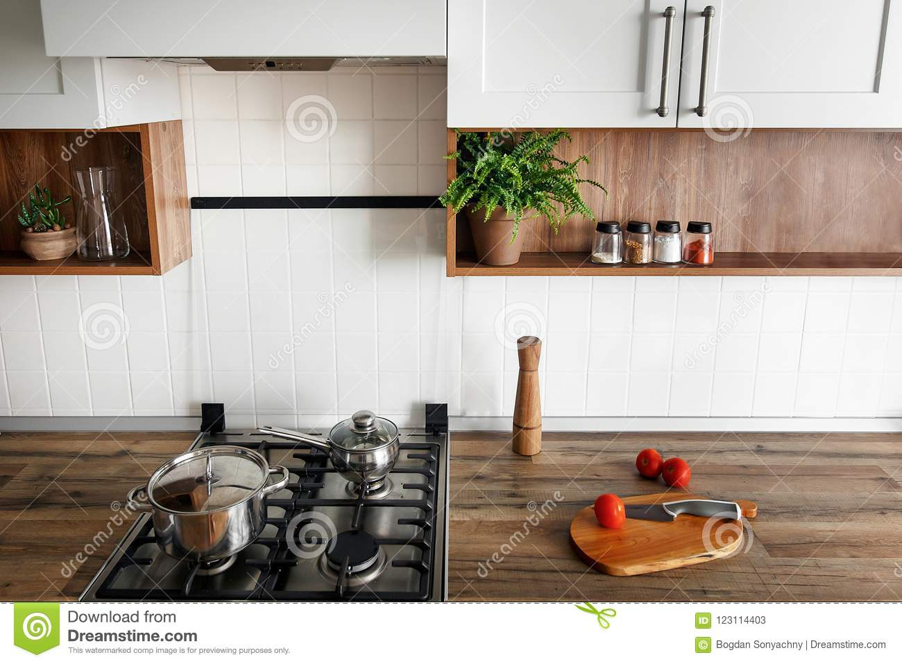 Download wooden board with knife tomatoes on modern kitchen countertop a stock image image