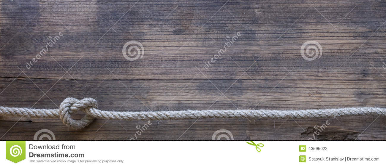 Brown Wooden Board With Rope: Wooden Board With A Rough Texture And A Rope Stock Photo