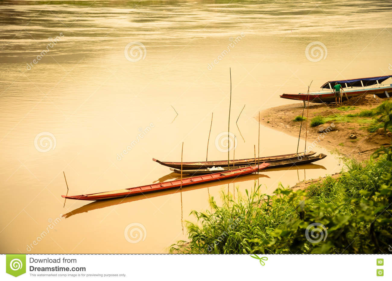 Wooden Boat At River Side