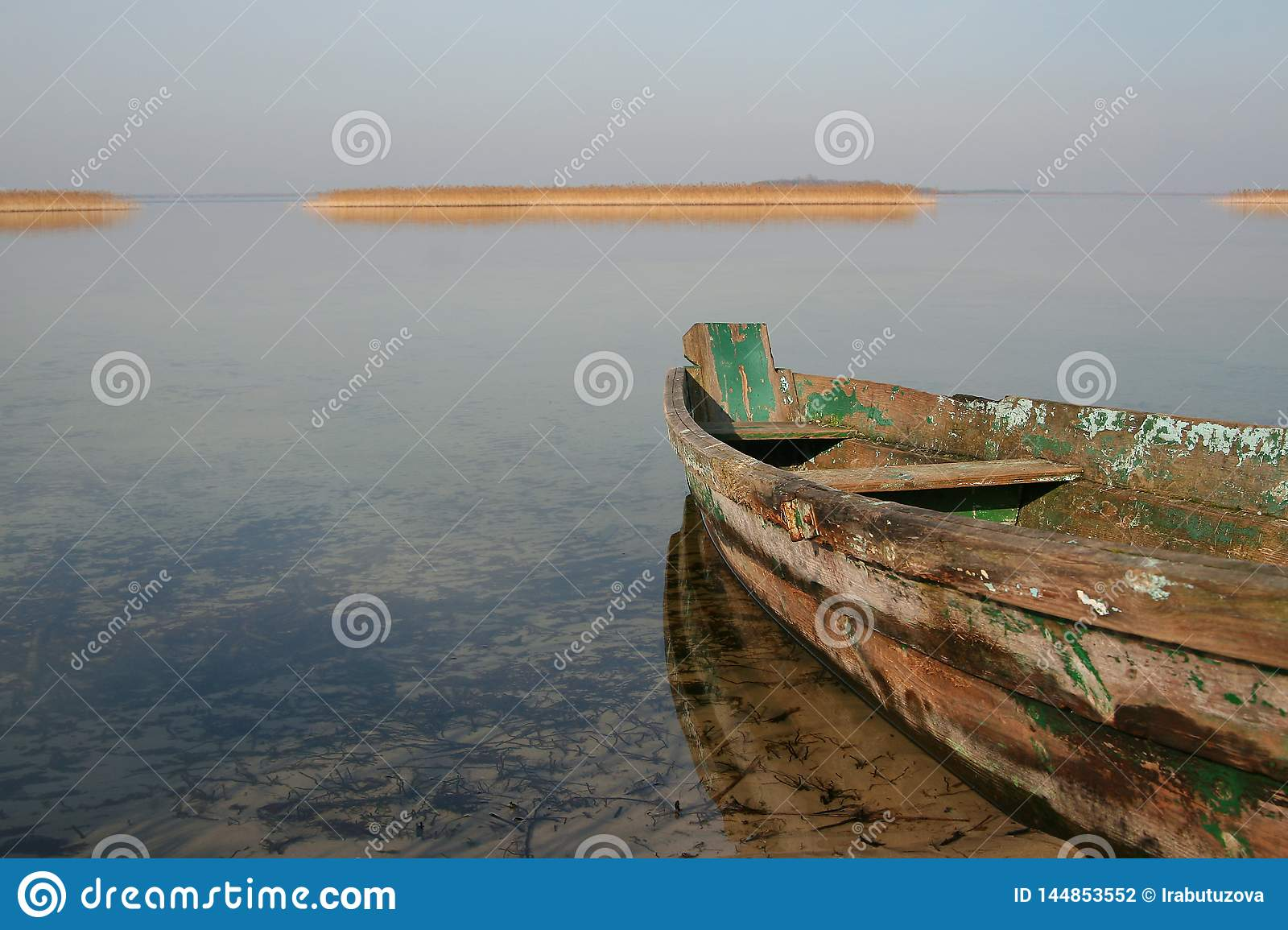 Old wooden boat on clear water