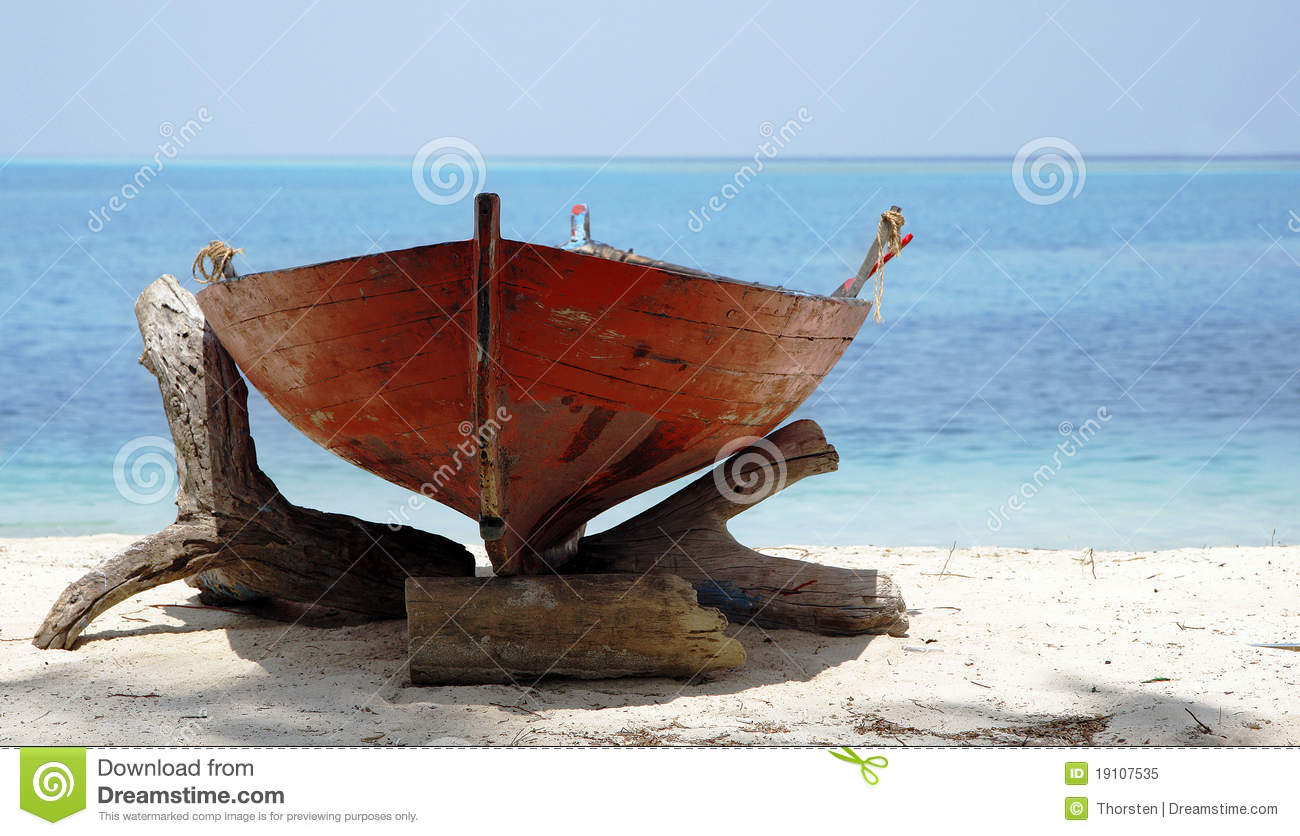 Wooden Boat On Sunny Beach