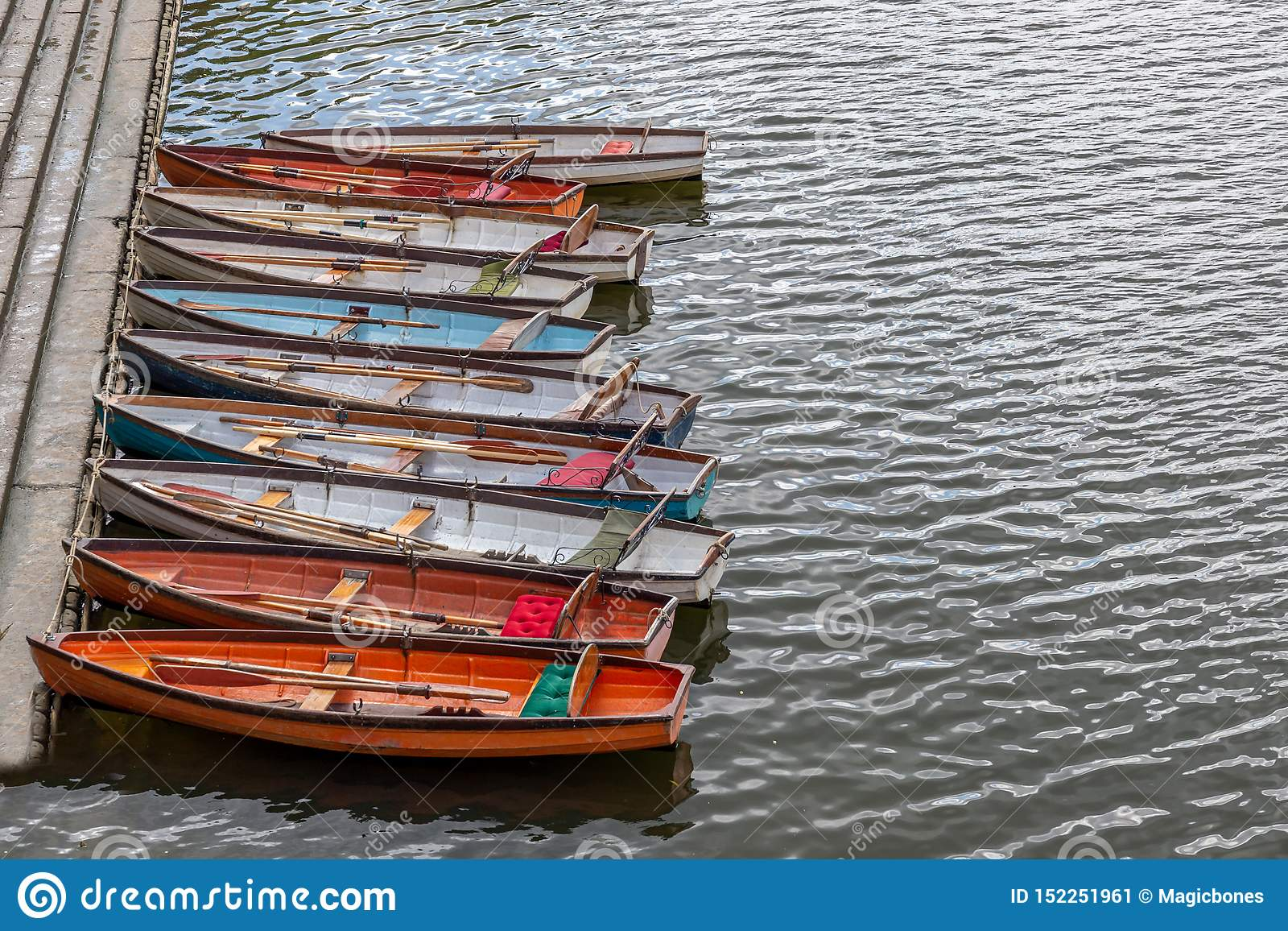 Wooden boats for hire moored on the River Thames
