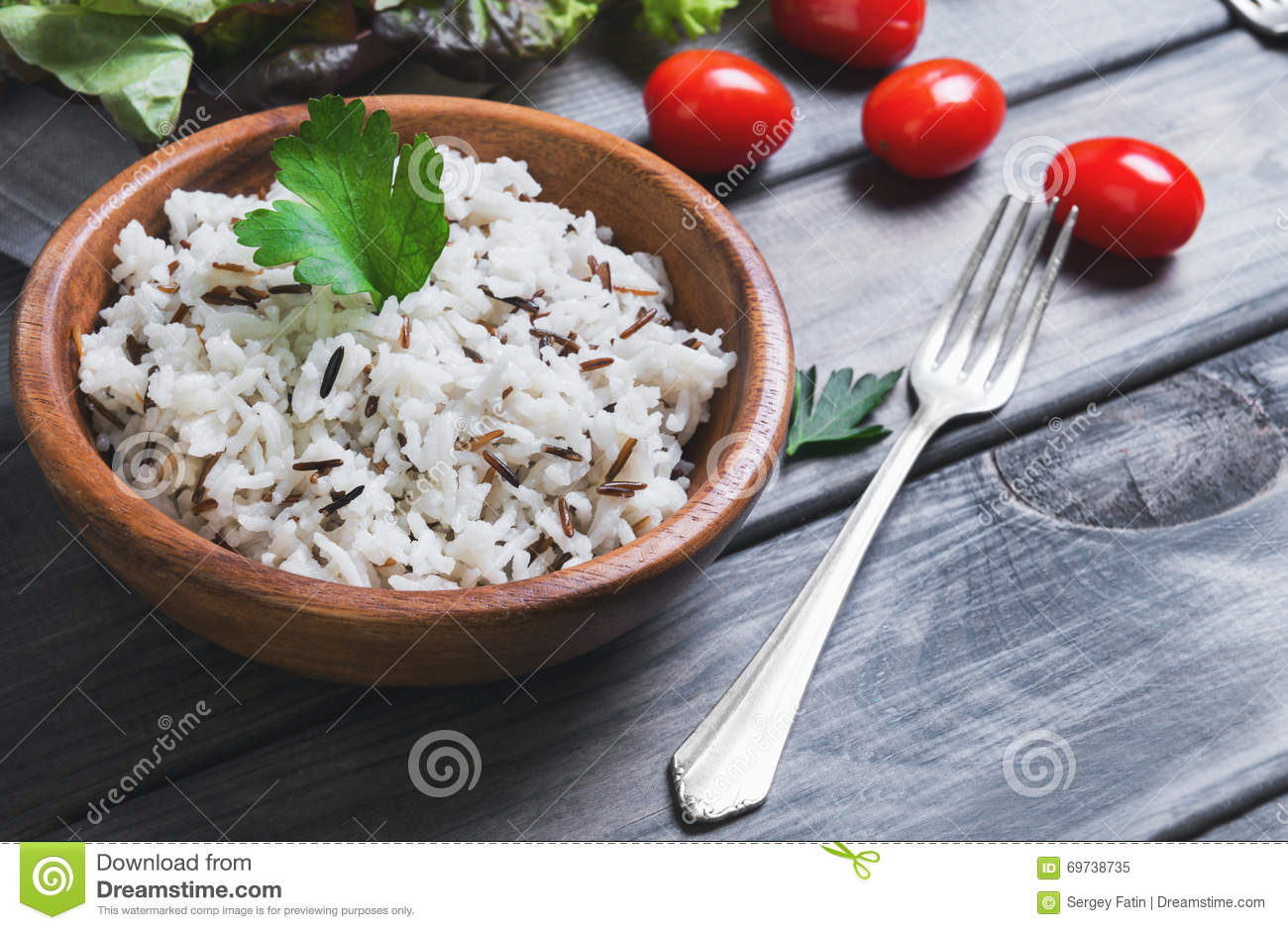 Wooden bowl with cooked white long-grain and wild rice