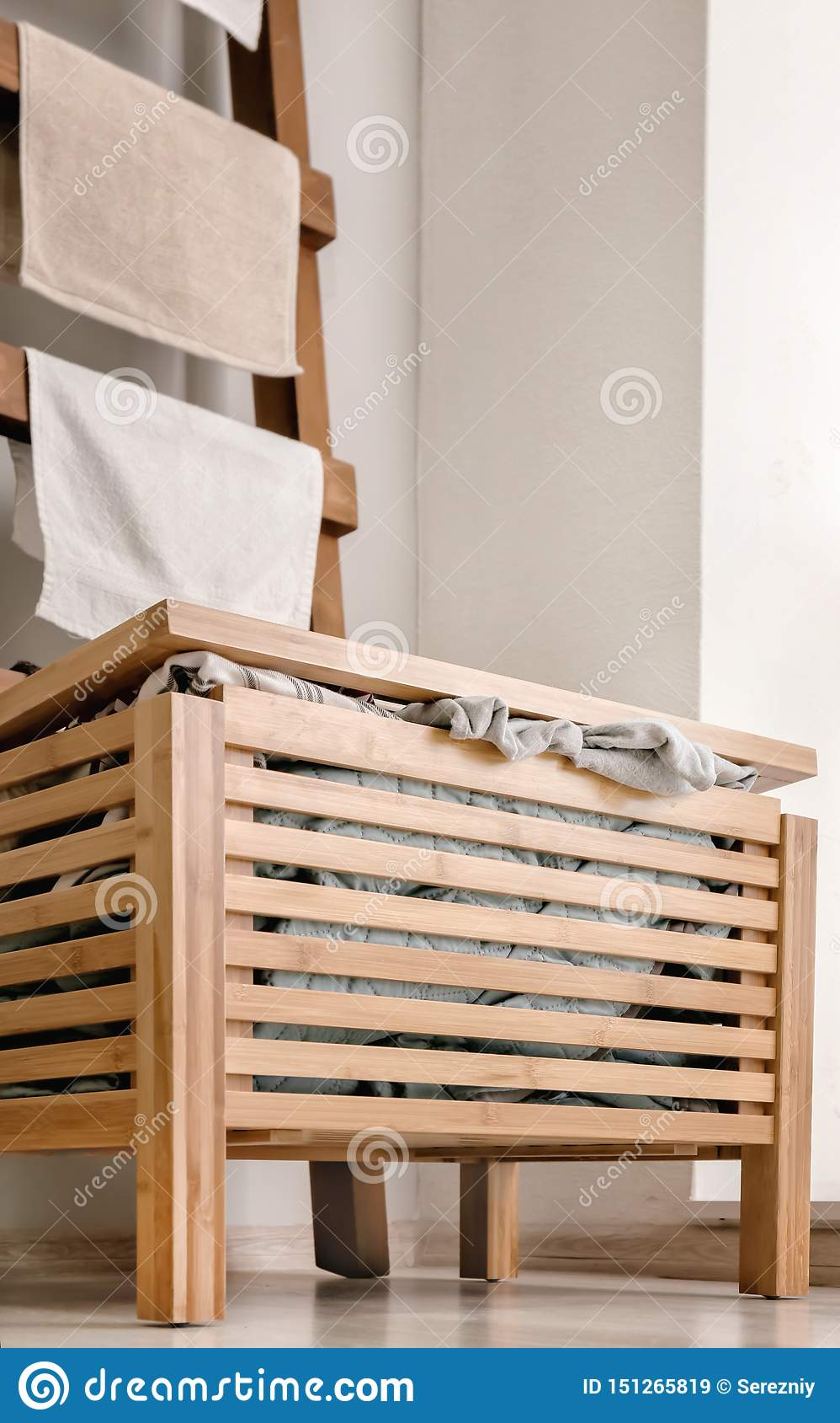 Wooden Box With Dirty Laundry In Bathroom Stock Image - Image of laundry, household: 151265819