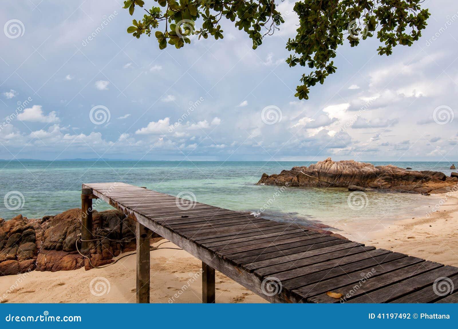 Wooden bridge into the sea Thailand