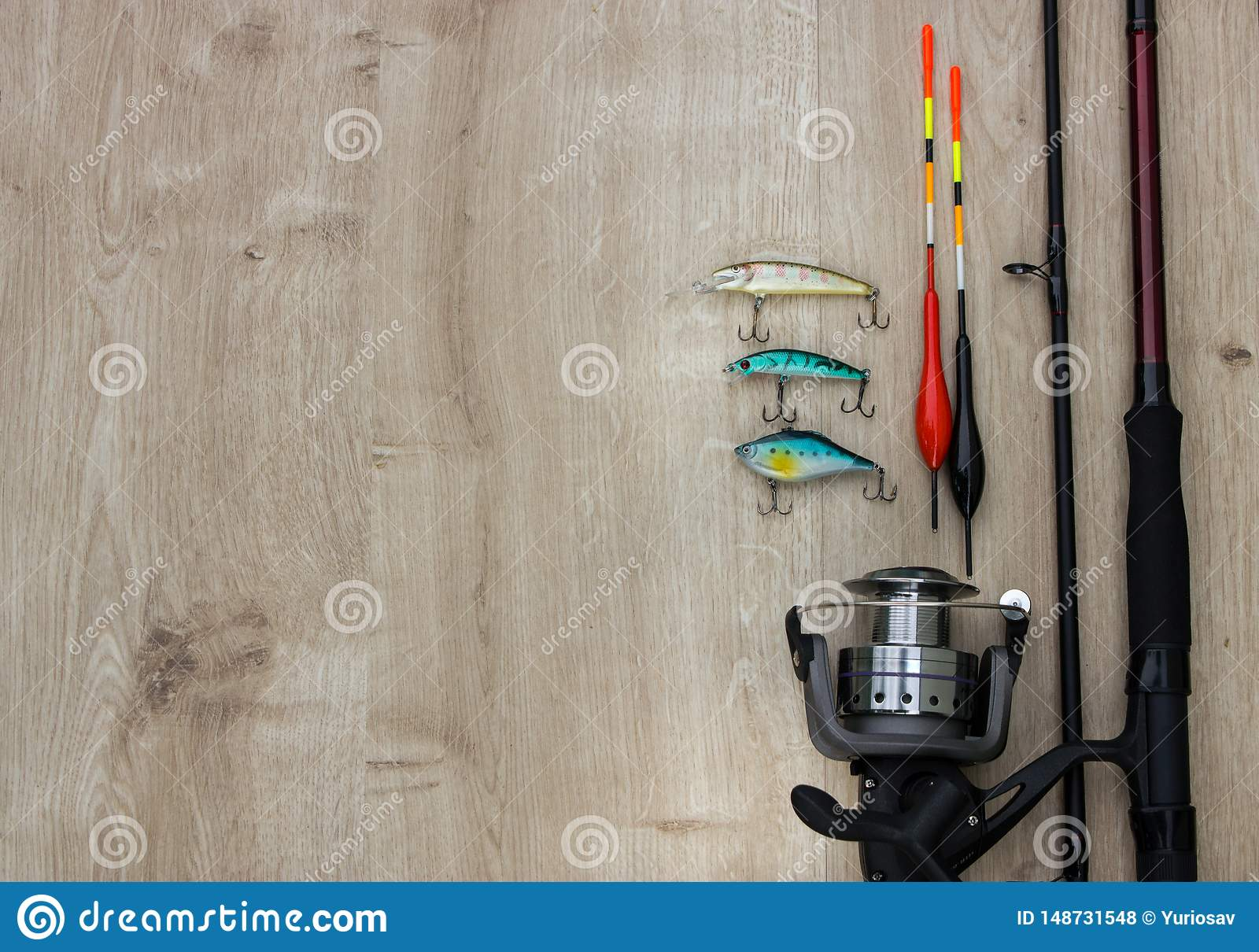 Wooden bridge with spinner lures and fishing bytes. Place empty can be used for text