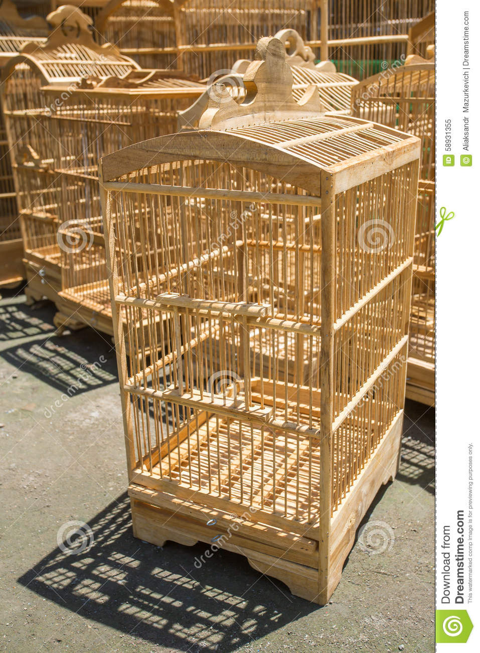 Wooden cages for birds at the pasar ngasem market in - Cages a oiseaux decoratives ...