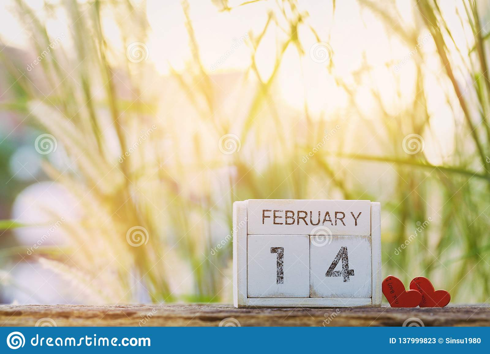 Wooden calendar show of February 14 with pink heart. Valentine`s Day, or St Valentine`s Day.