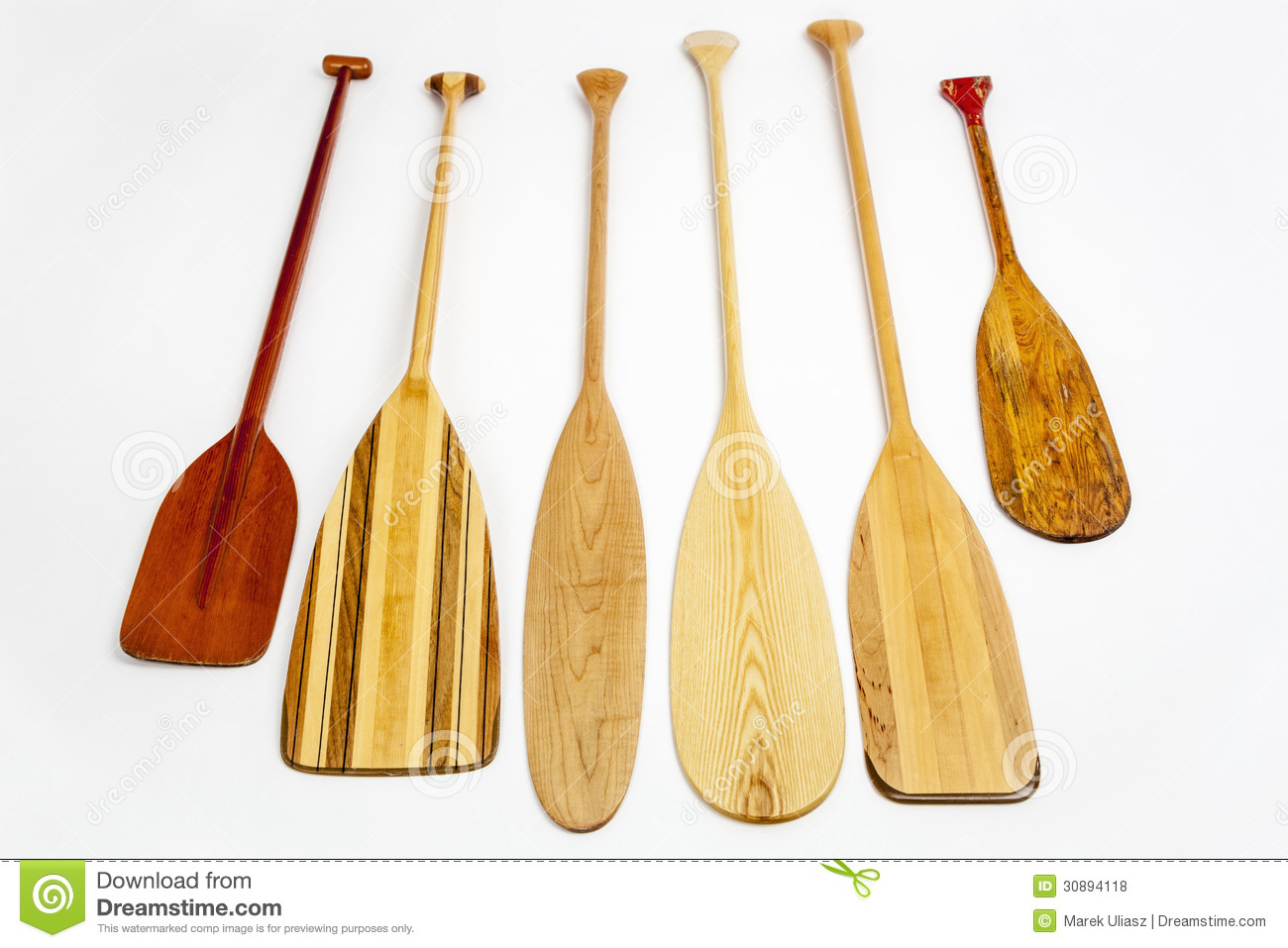 Wooden canoe paddles of different shapes and sizes including a classic ...