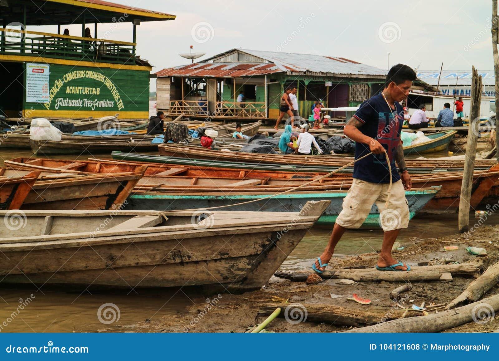 Wooden canoe in river port