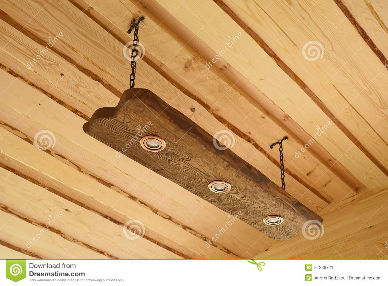 Suspended ceiling light in the form of an oak board with lights.