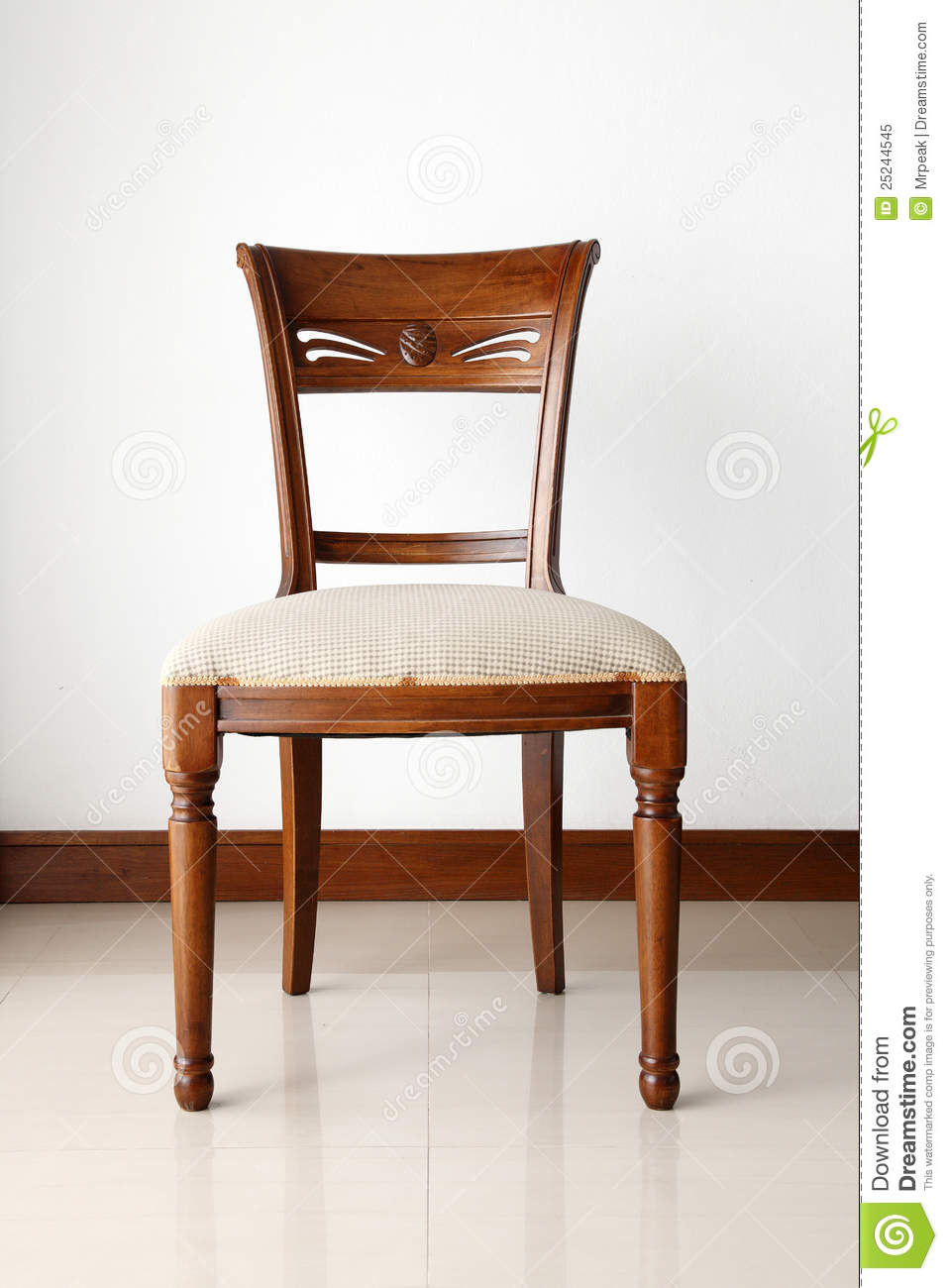 A Wooden Chair With Soft Cushion Royalty Free Stock Photo
