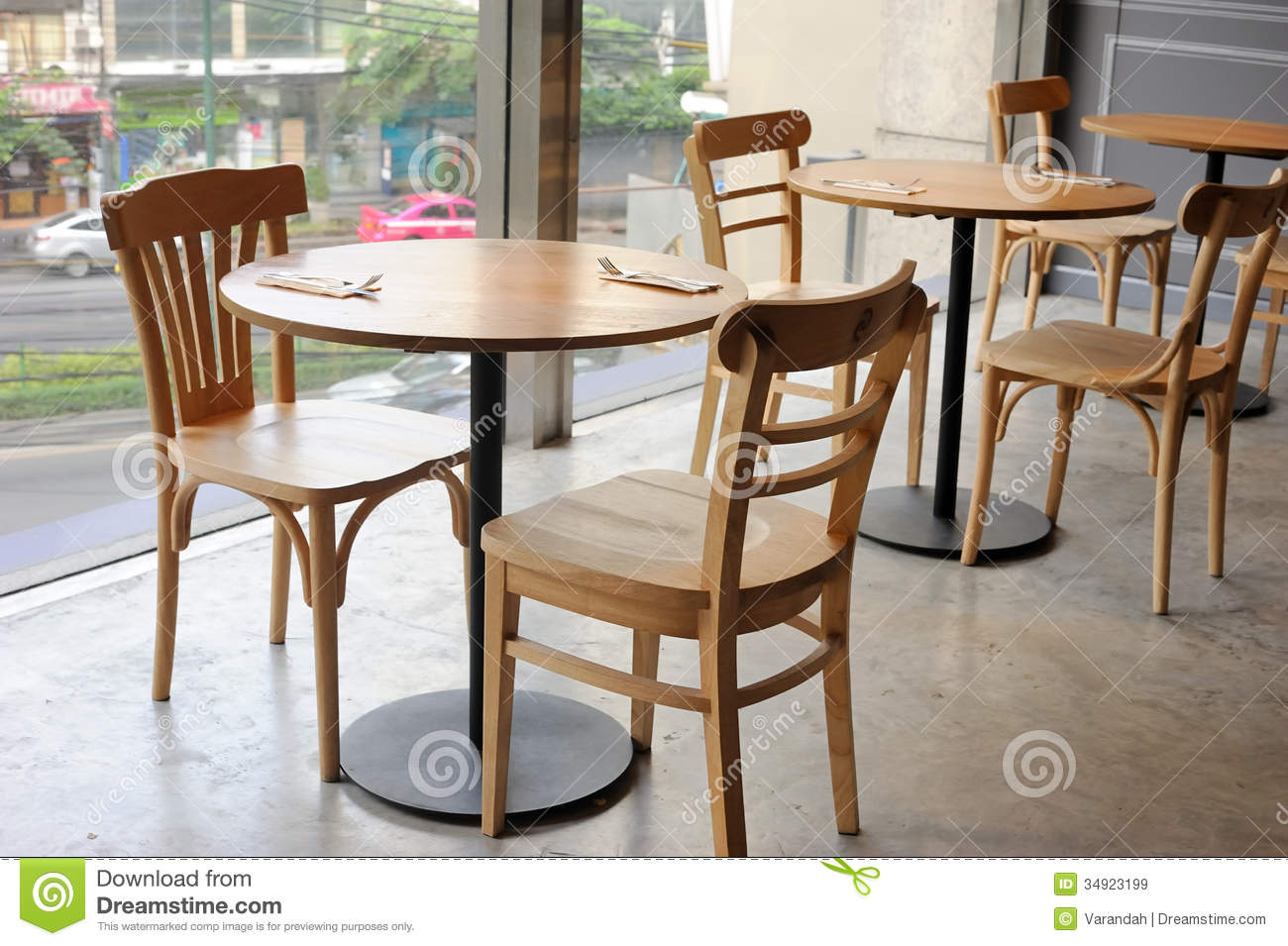 Exceptional Wooden Chair And Table In Cafe Near Glass Wall
