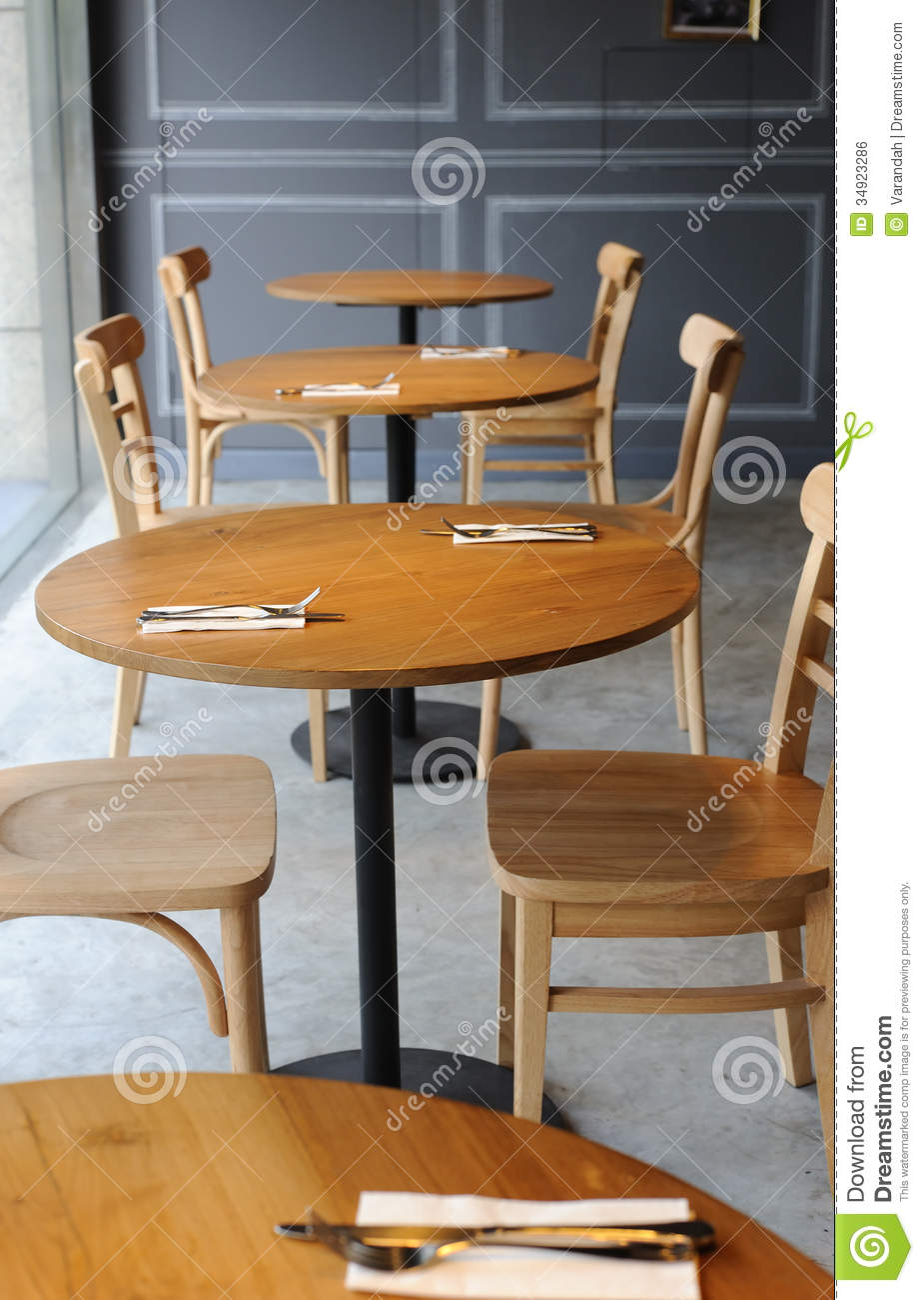Wooden Chair And Table In The Corner Of Cafe Royalty Free ...