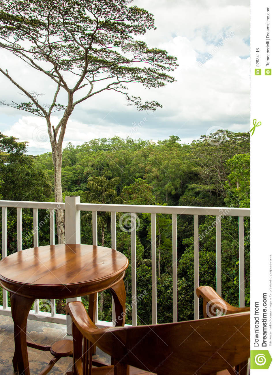 Wooden Chair And Table For 1 Person In A Balcony Overlooking A F