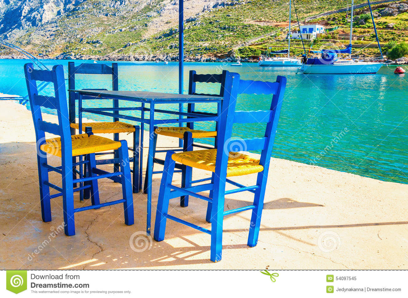 Wooden chairs in classic Greek resturant, Greece