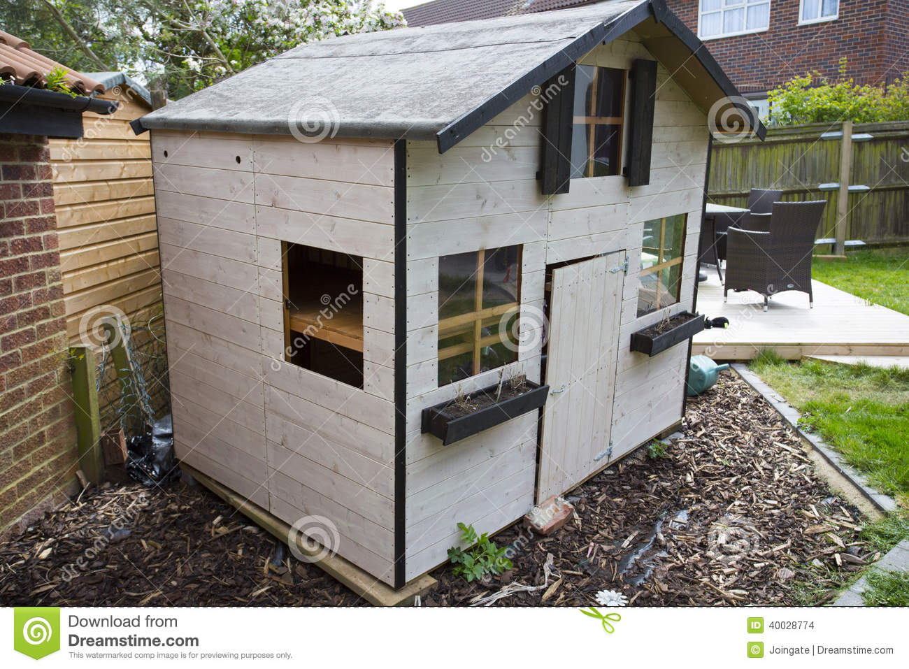 Wooden childrens garden playhouse or shed stock photo for Children s garden sheds