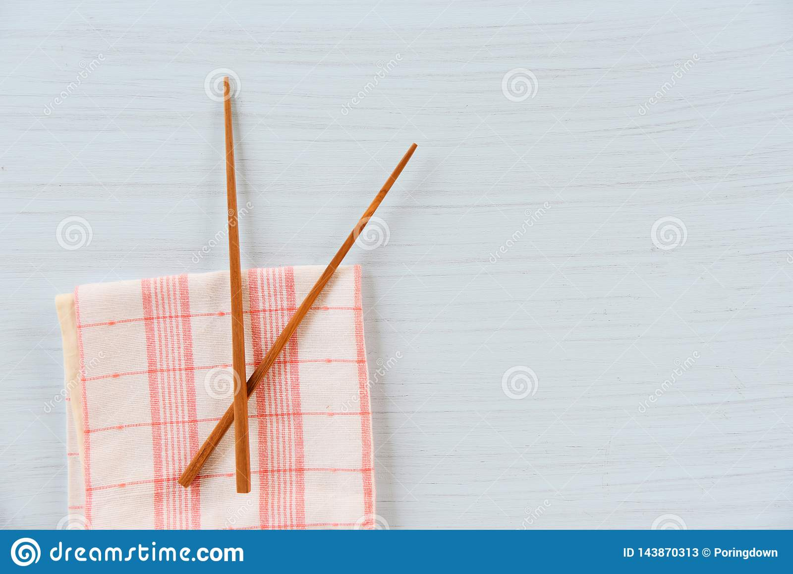 Wooden chopsticks kitchenware set on napery on dining table / Zero waste use less plastic concept