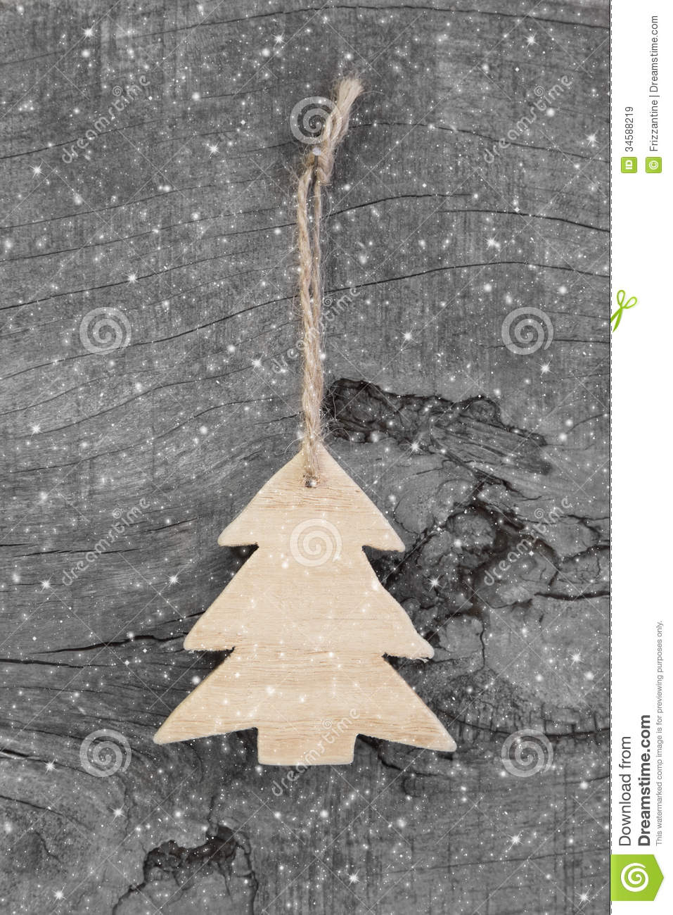 wooden christmas carved tree - shabby style on a grey background stock image