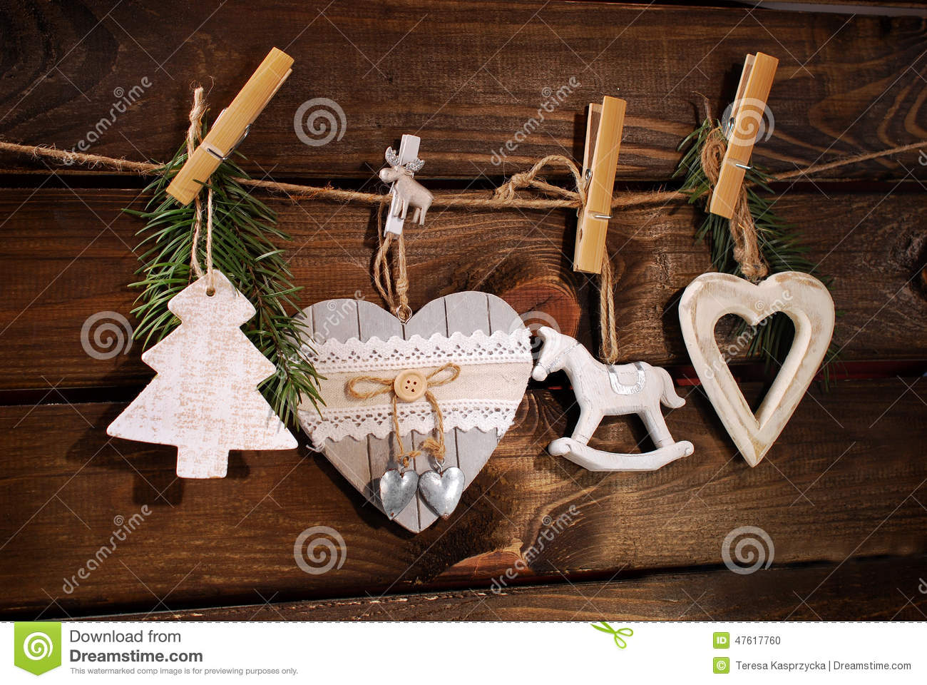 Wooden christmas decorations hanging on twine stock photo for Wooden christmas decorations