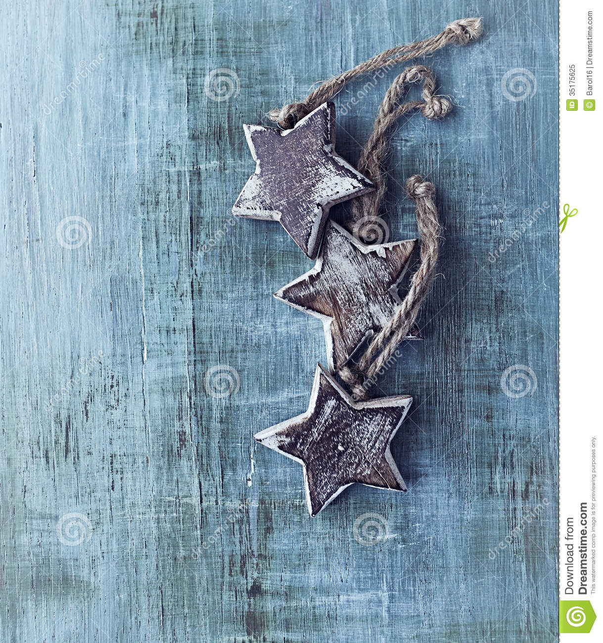 Wooden Christmas Stars On Painted Wood Stock Image