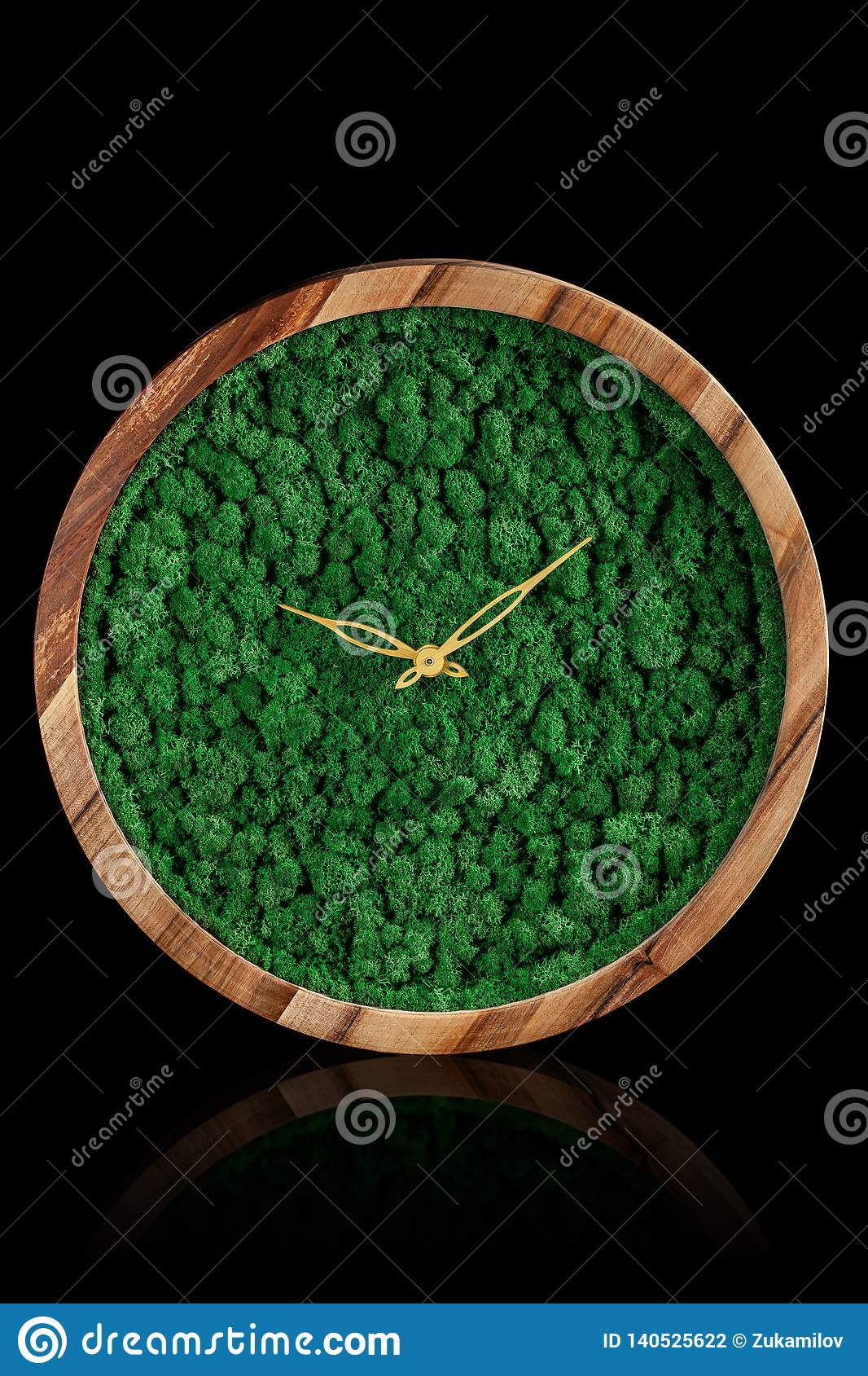 Wooden clock with color stabilized moss on a black background with mirror otgruzheniya. Trend 2019. Wall Clock copy space
