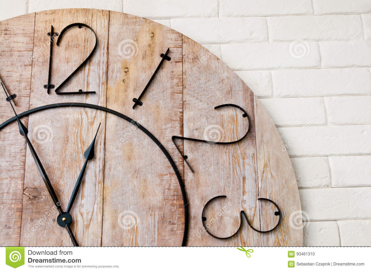Wooden clockface on white wall