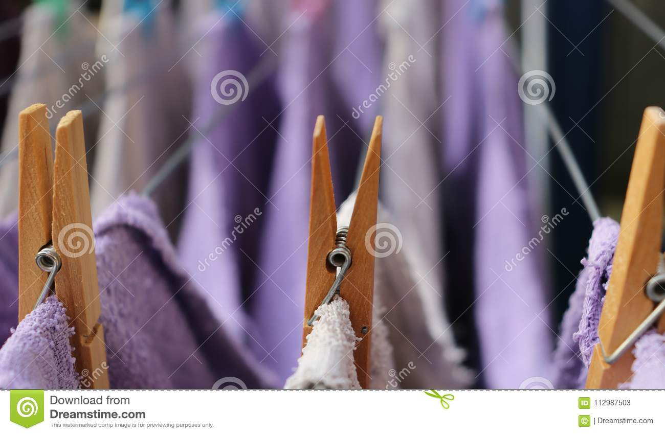 Wooden clothespins on a clothesline