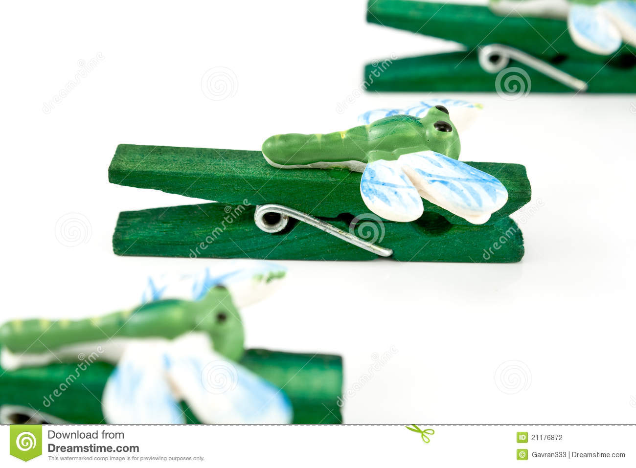 Wooden clothespins decorated with dragonflies