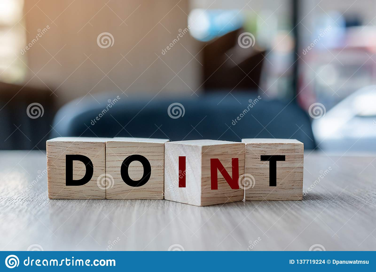 Wooden cube with flip over block DON T to DO IT word on table background. success, strategy, solution, business and Positive