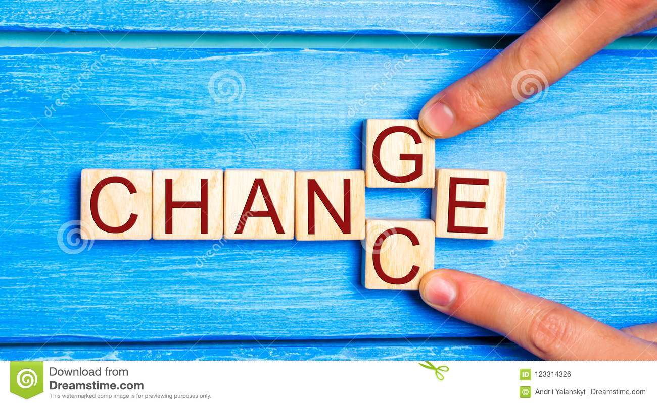 Wooden cube with word `change` to `chance` on wood table. Personal development and career growth or change yourself concept. conce