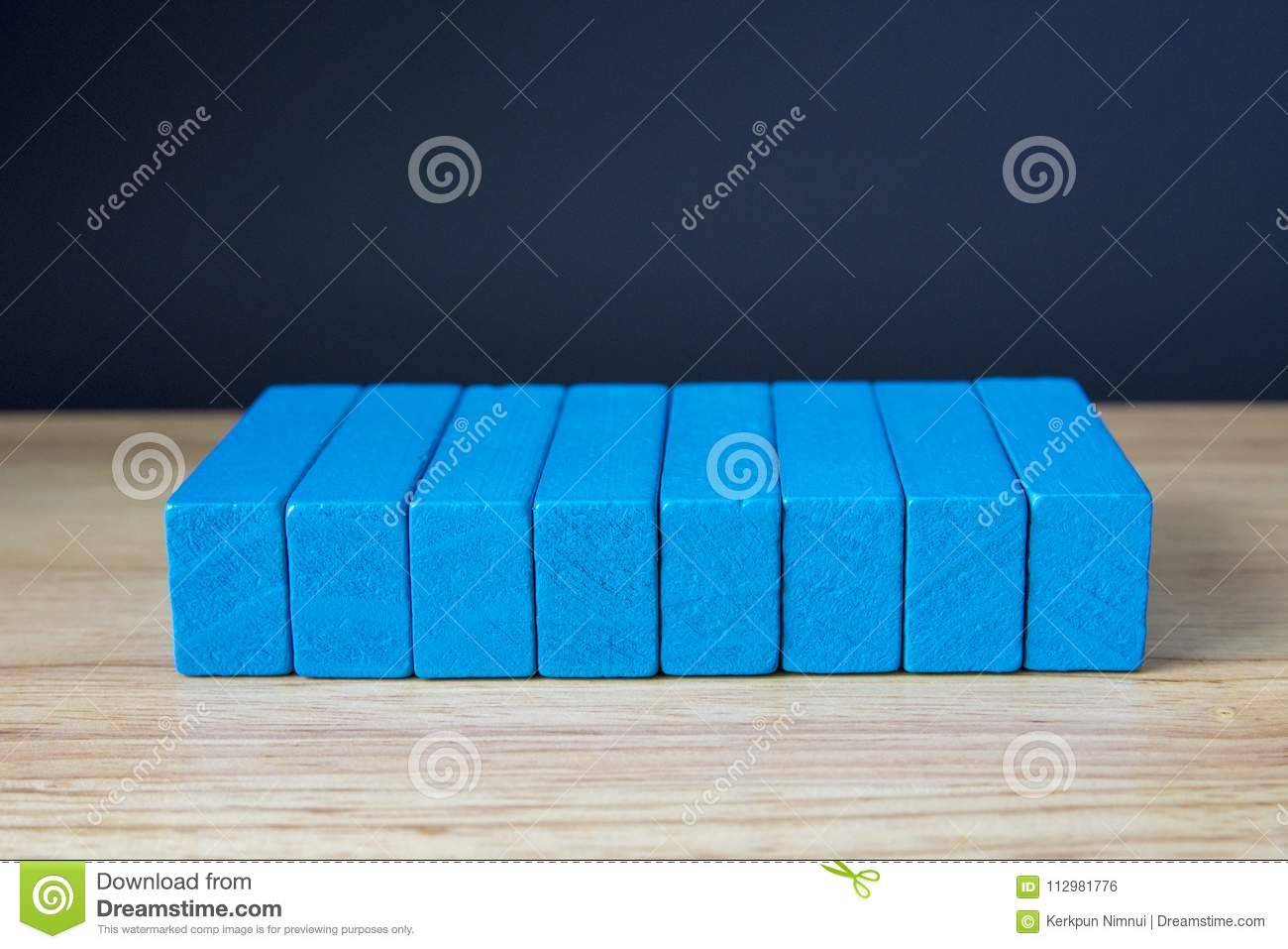 Wooden cubes on table over cement wall background