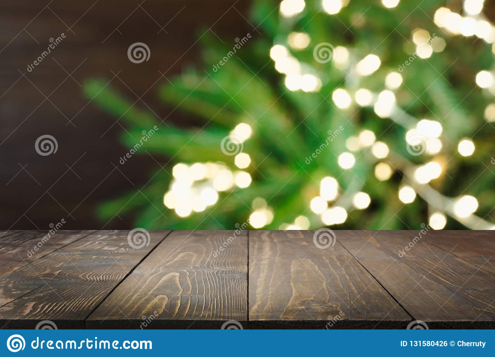 Wooden Dark Tabletop And Blurred Christmas Tree Bokeh Xmas