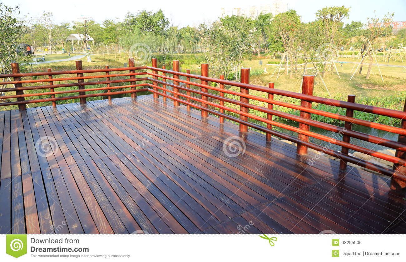 exterior wooden deck. Outdoor patio with wood balustrade and wood ...
