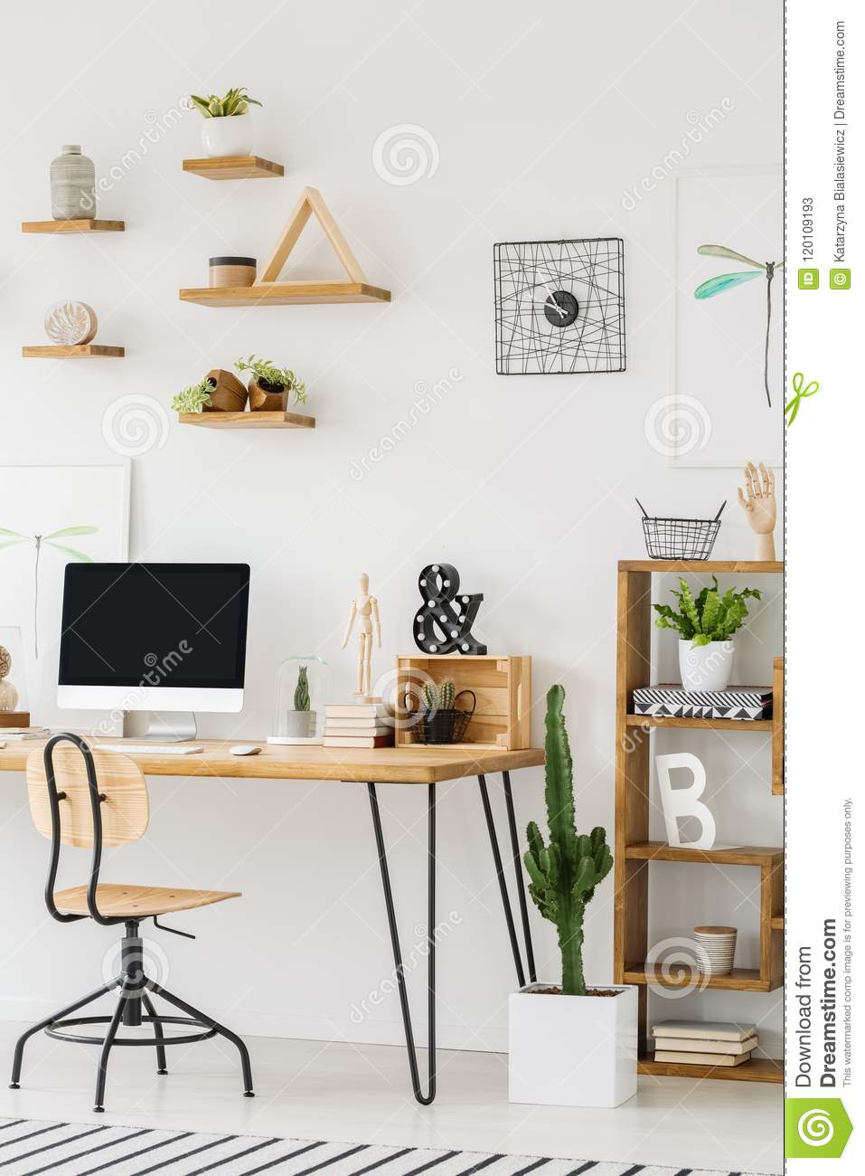 Wooden Desk With A Computer Chair Shelves On The Wall And