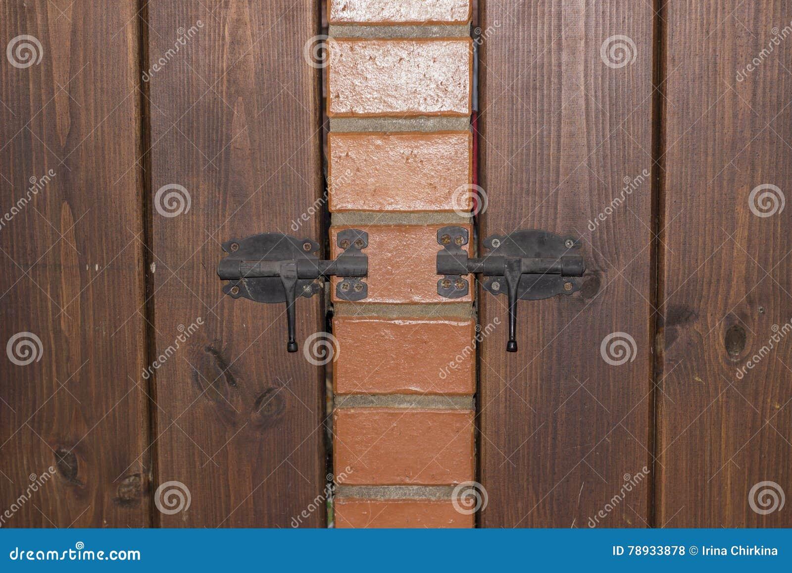 Wooden door on the latch